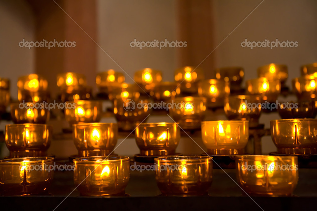 Row of burning candles in the dark — Stock Photo #10185475