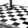 Chess king on board isolated on white — Stock Photo