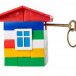 Toy house with golden key — Stock Photo