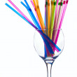 Multicolored straws in an empty glass — Stock Photo