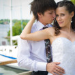 Bride and groom on white yacht background — Stock Photo