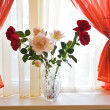 Bouquet of roses on window sill — Stock Photo