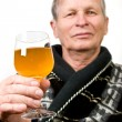 Elderly man with glass of wine — Stockfoto