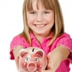 Little girl holding piggy bank — Stock Photo
