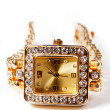 Stock Photo: Golden wristwatch with gems