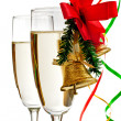 Champagne glasses decorated with Christmas bells — Stock Photo