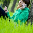 Royalty-Free Stock Photo: Pretty young college girl using cellphone