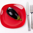 Blue eggplant on a red plate — Stock Photo