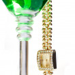 Wrist watch hanging from martini glass — Stock Photo