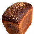 Loaf of crusty rye bread isolated - Stock Photo