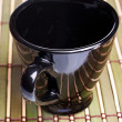 Coffe cup on bamboo mat — Stock Photo