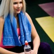 Beautiful young blonde in fitness club - Stock Photo