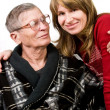 Woman looking with love at elderly father — Stock Photo