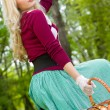 Beautiful young blond with basket in summer park — Stock Photo