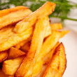Stock Photo: Potato fries with greenery