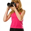 Pretty teenage girl with photo camera — Stock Photo