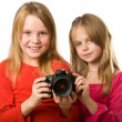 Two cute little girls with photo camera — Stock fotografie