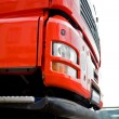 Moving red truck — Stockfoto