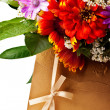 Flowers and golden colored envelope - Stock Photo