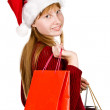 Teenager girl in christmas hat with shopping bags — Stock Photo #10371238