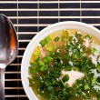 Foto Stock: Soup with greenery