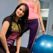 Stock Photo: Blond and brunette in fitness center