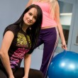 Blond and brunette in fitness center — Stock Photo