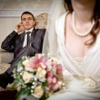 Stock Photo: Beautiful bride and groom in indoor setting