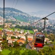 Cable railway and majestic cityscape revealing underneath — Stok fotoğraf