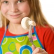 Little girl holding mushroom — Stock Photo #10371393