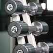 Stock Photo: Chrome dumbbells in row