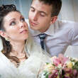 Beautiful young bride and groom in indoor setting — Stock Photo #10371397