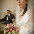 Beautiful bride and groom in indoor setting — Stock Photo