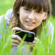 Young woman taking picture with digital camera — Stock Photo #10371436