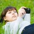 Young woman taking picture with digital camera — Stock Photo #10371455