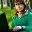 Stock Photo: Happy young woman with laptop