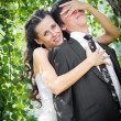 Bride and groom embracing — Stock Photo