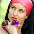 Fashionable young brunette with sunglasses — Stock Photo #10371517