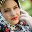 Beautiful young brunette wearing kerchief — Foto Stock