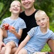Happy dad with twin boys - Stock Photo