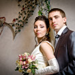Beautiful young bride and groom in indoor setting — Stok Fotoğraf #10371541