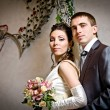 Стоковое фото: Beautiful young bride and groom in indoor setting