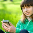 Pretty teenage girl with smartphone — Stock Photo