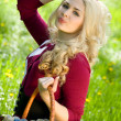 Beautiful young blond with basket in summer park — Stock Photo #10371607