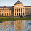 Historical building with fountains and pool in Wiesbaden - Stock Photo