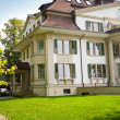 European house with green lawn — Stock Photo
