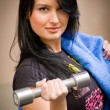 Young smiling woman with a dumbbell — Stock Photo #10371626