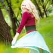 Beautiful young blond wearing long skirt in summer park — Stock Photo #10371633