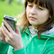Pretty teenage girl with digital assistant electronic device — Stock Photo