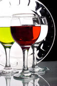 Glasses with multicolored liquids — 图库照片